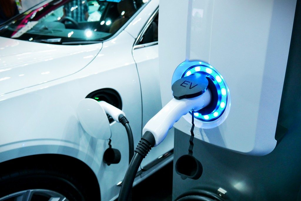 charging a white electric car