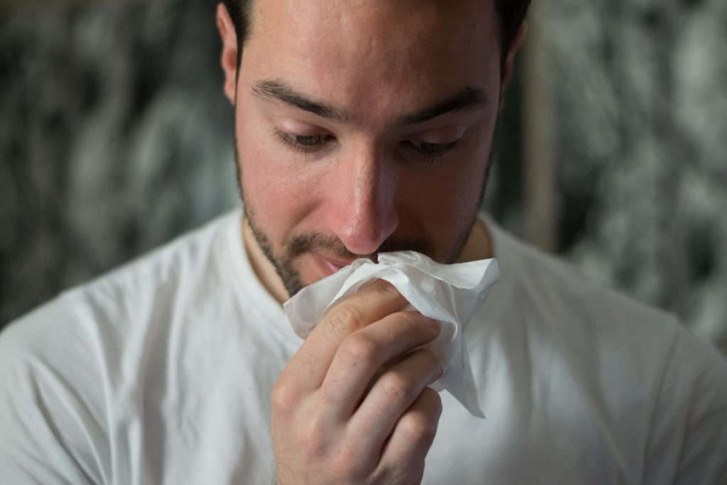 man-wiping-his-nose