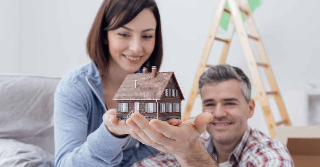 couple with a house miniature