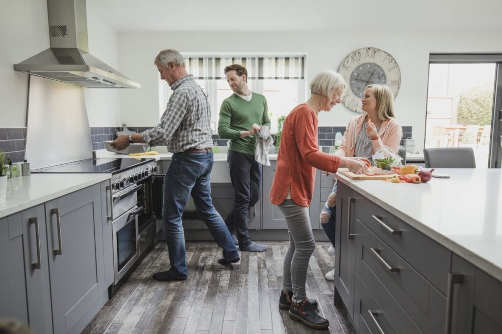 adult and elders cooking in the kitchen