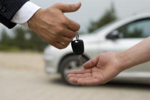 person handing over car keys