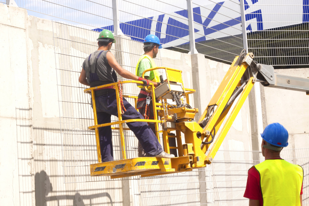 construction workers on a lift